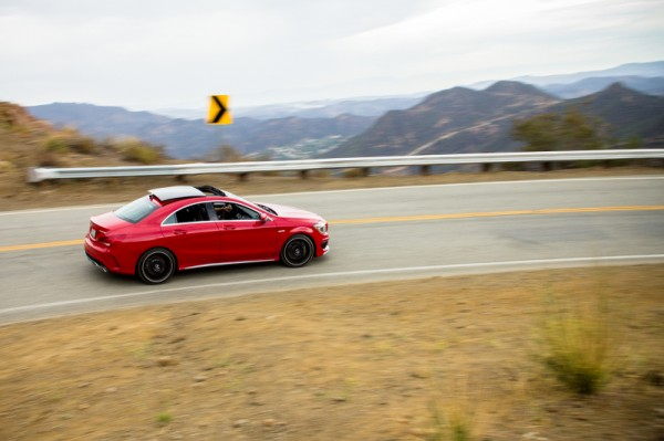 Red 2014 Mercedes CLA AMG Mulholland Highway Curve