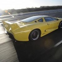 Yellow Jaguar XJ220 Driving TWR