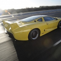 Yellow Jaguar XJ220 Driving TWR
