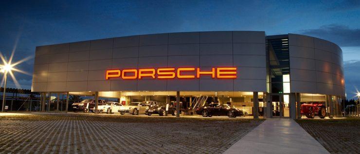 Porsche dealership at night.