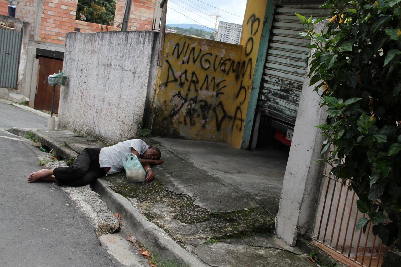 Man Sleeping on the Street in Rio's Favelas