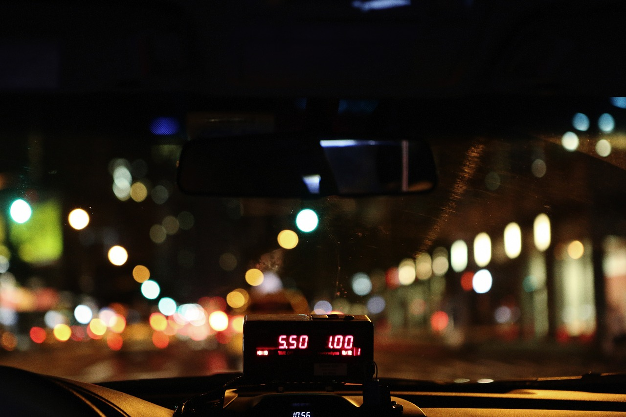 Dbs Checks Taxi meter in a cab at night