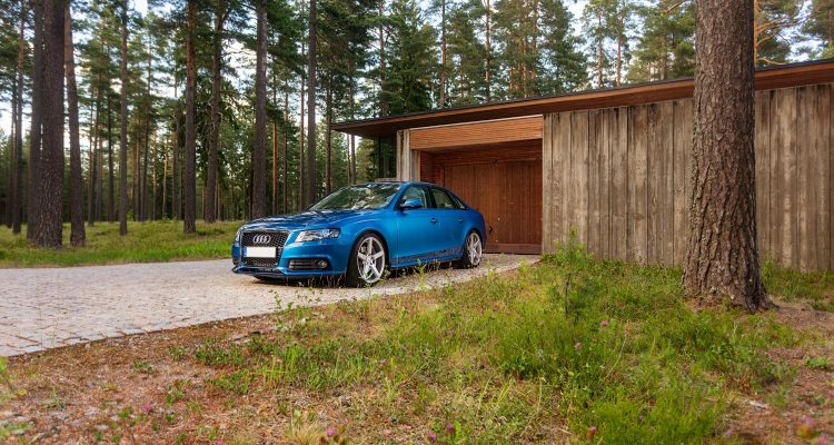 Used Cars blue bmw m 3 parked near brown wooden house