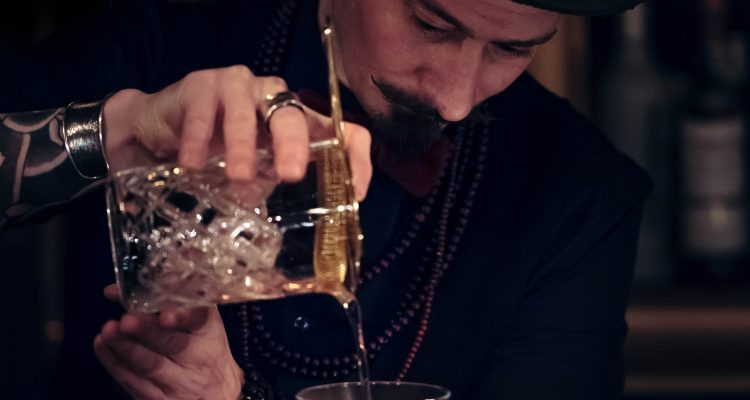 man pouring the wine glass