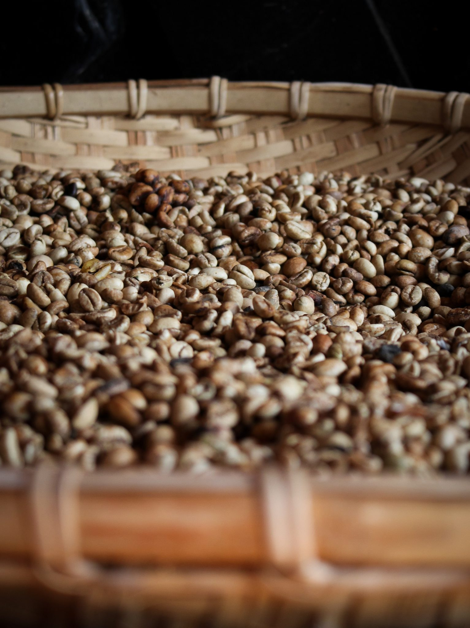 coffee beans on brown woven basket
