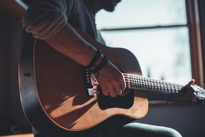 Leather Accessories Home Studio man playing acoustic guitar selective focus photography