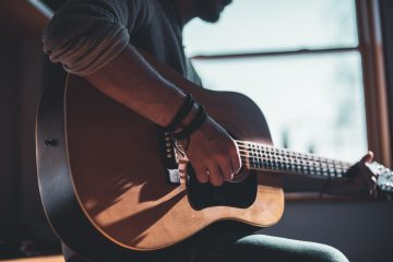 First Guitar Leather Accessories Home Studio man playing acoustic guitar selective focus photography