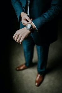 Style Hacks watch man holding his black suit