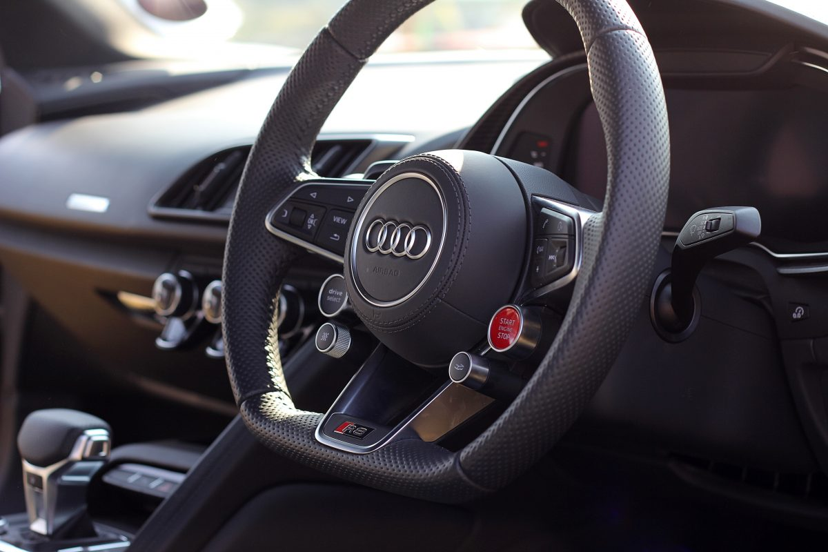 black and gray Audi steering wheel
