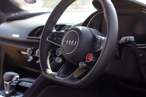 Car In The UAE Luxury Cars Luxury Car Market Trends black and gray Audi steering wheel