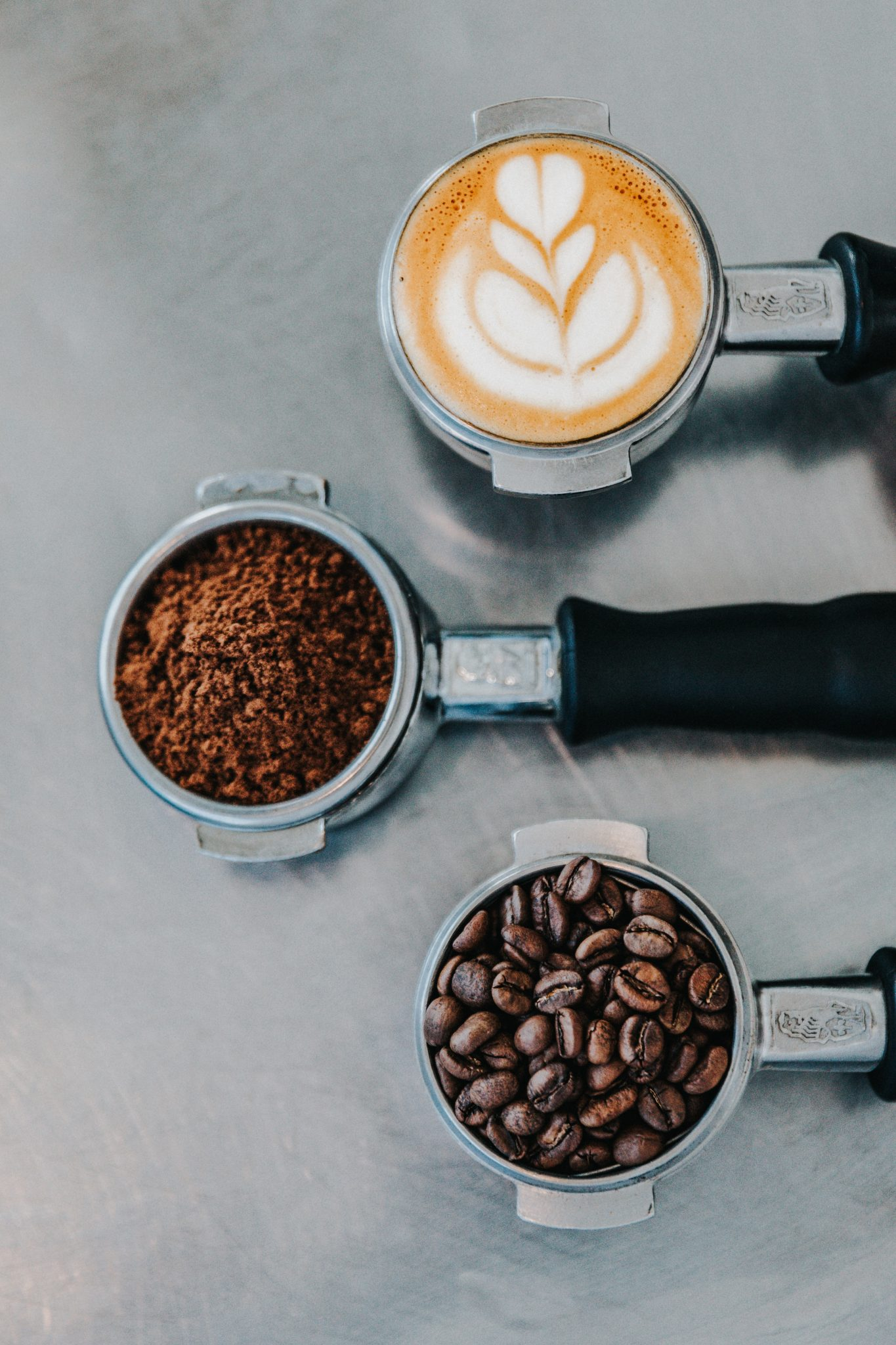 Benefits Of Drinking Coffee flat lay photography of coffee latte, ground coffee, and coffee beans