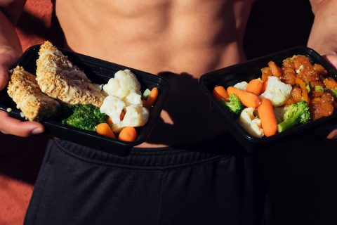 Healthy Eating Fitness Mistakes Beef Recipes topless man in black shorts holding cooked food