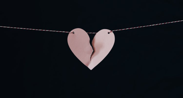 Divorce Attorney broken heart hanging on wire