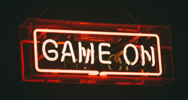 Promote red and white Game On neon signs