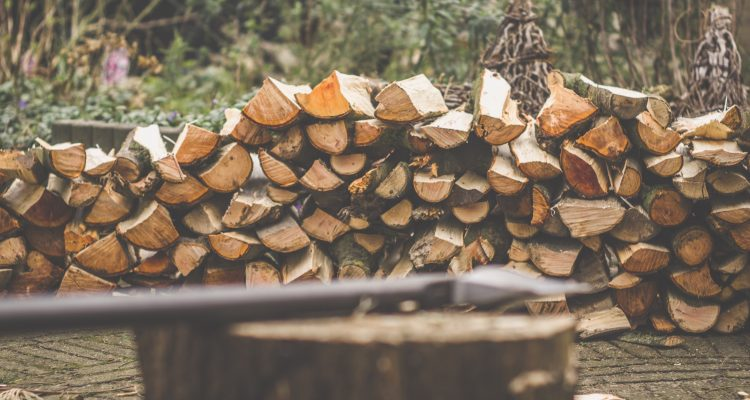 tomahawk brown firewood on brown wooden log