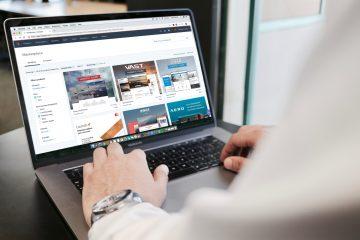 WordPress Theme standing desk person using MacBook Pro