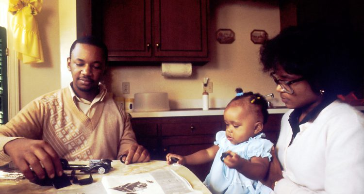 Relationship Feeding Your Child Reconnect with Your Family Life Insurance man and woman with child sitting beside table
