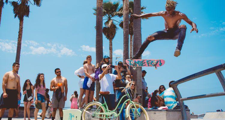 Miami Skateboarding Safety person watching man using skateboard doing tricks during daytime