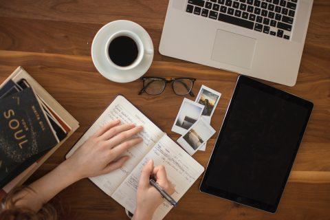 Risks Ice Breaker Ideas Marketing Strategy person holding ballpoint pen writing on notebook