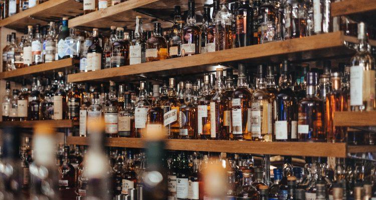Booze Guide assorted-color bottle lot on shelf