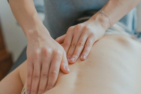 back pain Relax Health and Fitness Massage Physiotherapist man massaging woman's body