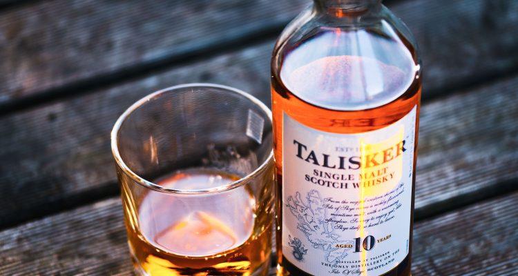Drinks Game Talisker bottle beside drinking glass