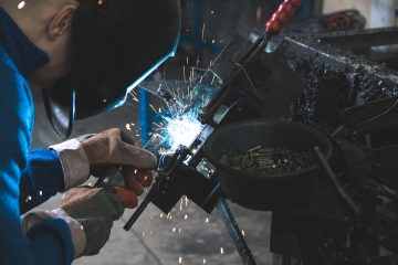 Injured At Work MIG Welding man welding a black metal