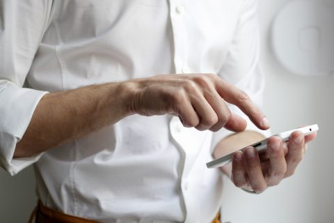 Marketing Automation Plan Data Only Plan person holding white Android smartphone in white shirt