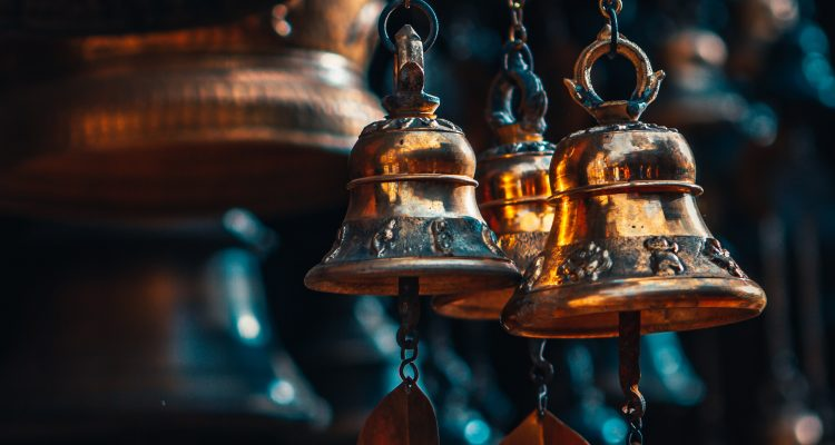 Musical Instruments gold bell hanging on brown wooden wall