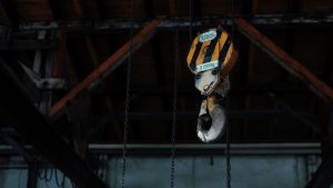 Injured At Work Rent a Crane yellow and black chain hoist