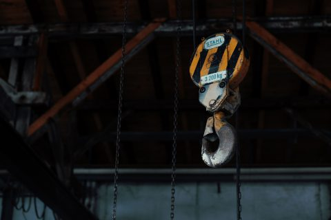 Workers' Compensation Claim Injured At Work Rent a Crane yellow and black chain hoist