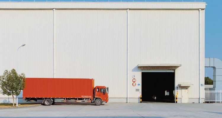 trucking Commercial Driver's License Obtaining a CDL red freight truck beside building