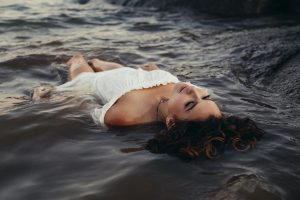 chemise woman relaxing on body of water