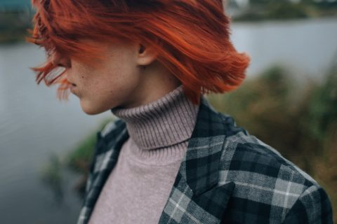 Hairstyles for Red Hair woman in black and white plaid shirt with red hair