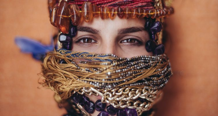 Teardrop Plugs shallow focus photography of woman covered of accessories